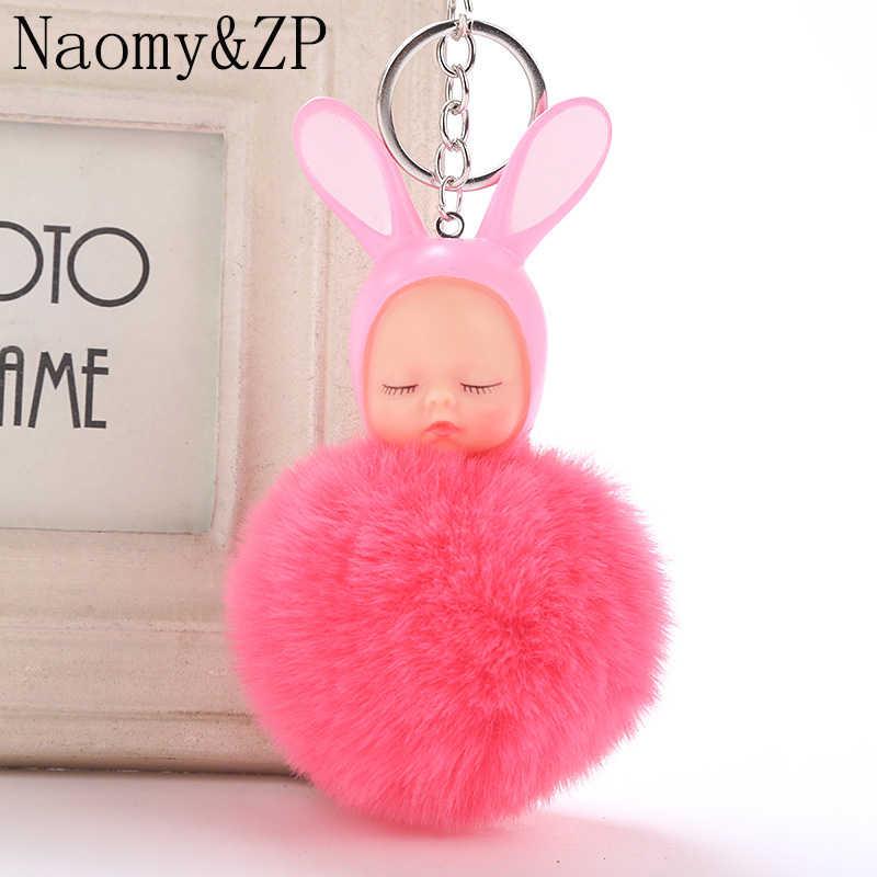 Naomy & ZP dormir Bebé muñeca llavero pompón coche llavero mujeres conejo piel bola llavero encanto Accesorios bolsa colgante