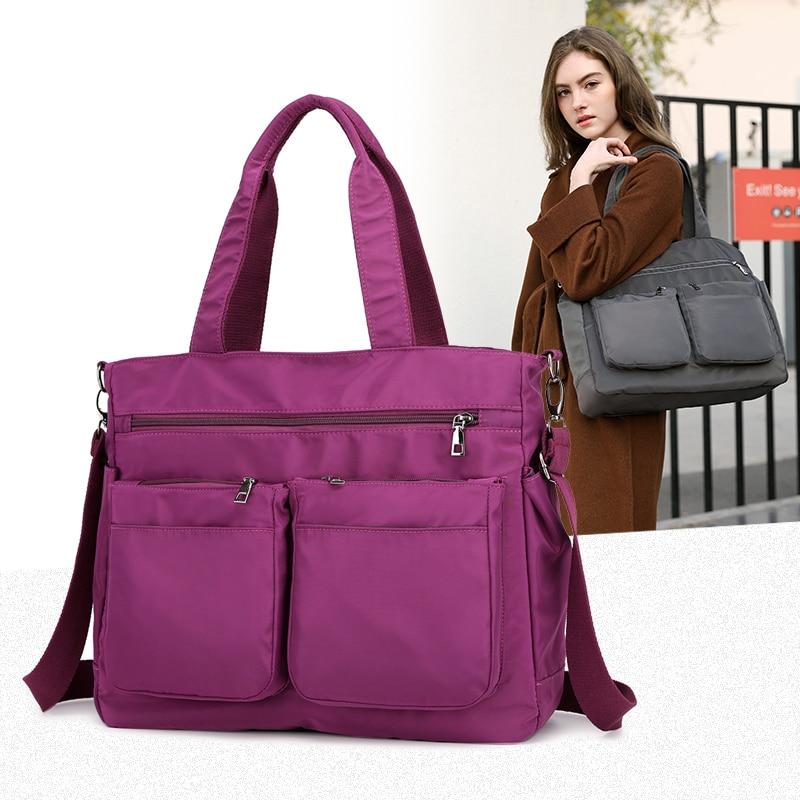 dd3769bcbc3c2 2019 جديد النساء السفر أكياس الرجال سفر حقائب قماش النايلون للماء اليومية  حقيبة يد للسفر حقيبة