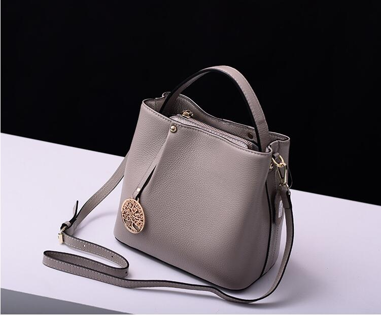 2018 first layer cowhide women's bucket bag genuine leather lady's messenger bag one shoulder cross body bag qiaobao 2018 new korean version of the first layer of women s leather packet messenger bag female shoulder diagonal cross bag