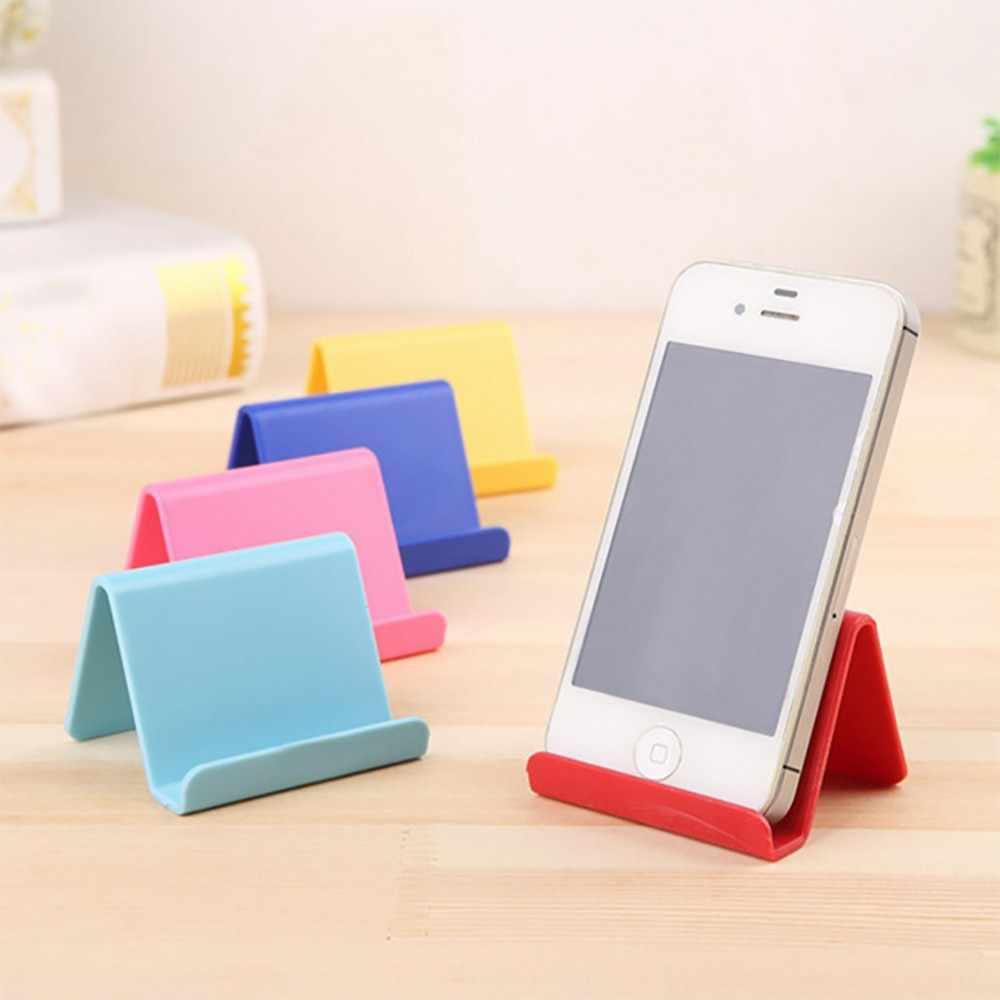 * Mini soporte de teléfono fijo portátil soporte de teléfono lindo estante de almacenamiento de plástico Color caramelo soporte de teléfono móvil estante organización 0.334