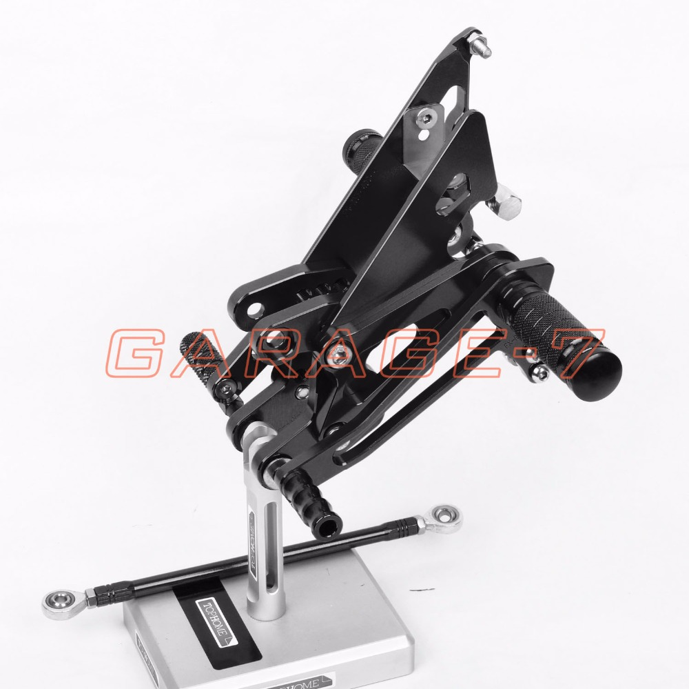 One Pair Of High-quality Motorcycle CNC Rearsets Adjustable Rear Set Foot Pegs For Honda NC30 RVF400 NC35 All Years Black