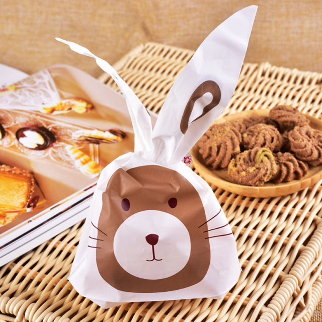 Online shop tronzo 50pcs easter bunny cookies bag wedding favors tronzo 50pcs easter bunny cookies bag wedding favors and gifts cute rabbit ear plastic candy gift bag birthday party supplies negle Choice Image
