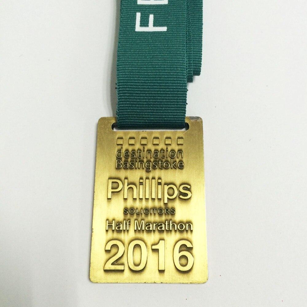っMedalla de Oro con logotipo personalizado en relieve en forma de ...
