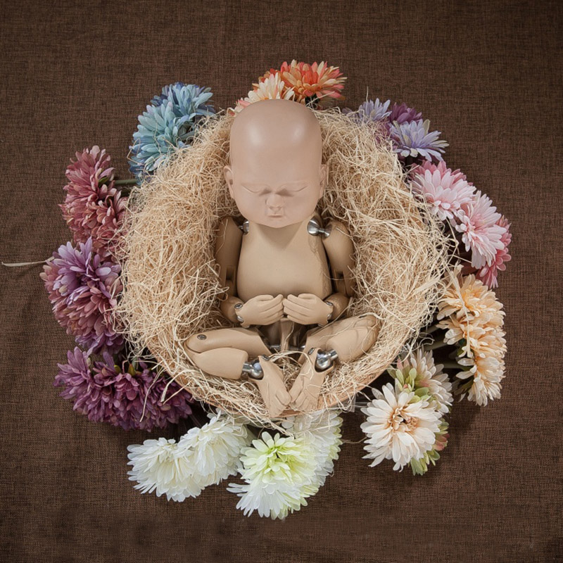 newborn photography practice doll