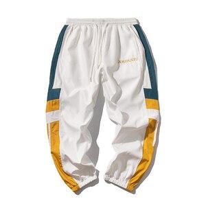 Image 4 - Joggers Sweatpants Men Casual Striped Pants Fashion Loose Track Pants Men Sweat Pants Sports Japanese Streetwear White Black