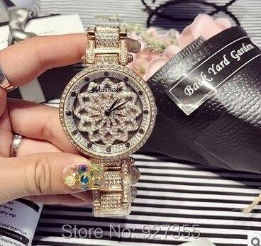 Nouveau chanceux fleur femmes montre dame brillant Rotation robe montre grand diamant pierre montre-bracelet violet montre horloges heures