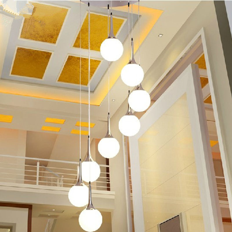 Modern minimalist stair chandelier rotating long chandelier Villa double creative glass ball personality restaurant LED lights minimalist villa long lighting stairs lights white ceramic stair stair lamp pendant lamps rotating modern pendant lights