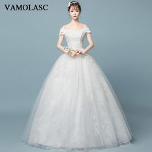 VAMOLASC Crystal Boat Neck Lace Appliques Ball Gown Wedding Dresses Pearls Tassel Short Sleeve Backless Bridal Gowns