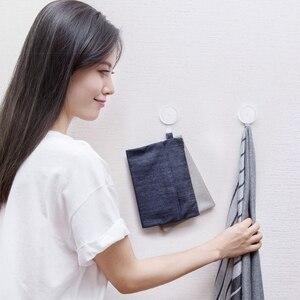 Image 2 - Youpin pequenos ganchos de parede, adesivo forte, suporta carga de até 3kg para parede de banheiro, quarto, cozinha vida doméstica inteligente,