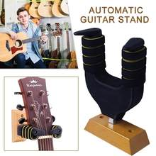 New Design Guitar Wall Hook Wooden base Auto Lock Gravity Lock Barb Non-slip Fall prevention Guitar Ukulele Violin Holder Stand(China)