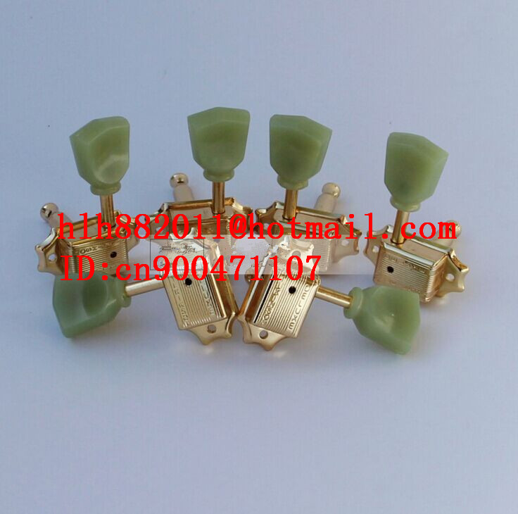 free shipping new electric guitar jade tuning peg in gold guitar button  WJ44   N22 free shipping new electric guitar jade tuning peg in gold guitar button wj44 n22