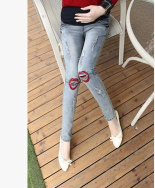 2017 roupas Grávidas Outono Coreano moda Jeans maternidade calças barriga grávida calças buraco lápis labial SH-3035JYF