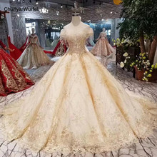 LS11250 dubai wedding dress with long train off shoulder tassel appliques shiny wedding gown ball gown sweetheart bride dresses(China)