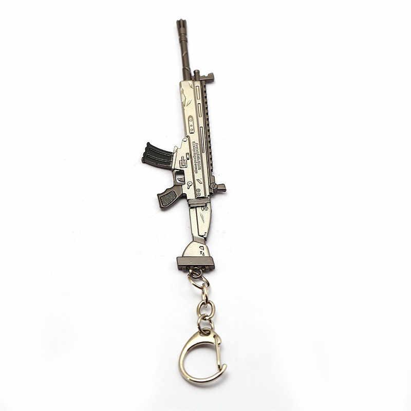เกม AWM Sniper ปืนไรเฟิลพวงกุญแจ 12 เซนติเมตรรอยแผลเป็น M4 ปืน Battle Royale Key Chain แหวนโลหะรถผู้หญิงกระเป๋า chveiro llavero เครื่องประดับ