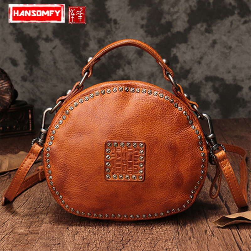 The first layer of leather Women handbag genuine leather rivet pouch retro bills female shoulder slung small round messenger bagThe first layer of leather Women handbag genuine leather rivet pouch retro bills female shoulder slung small round messenger bag