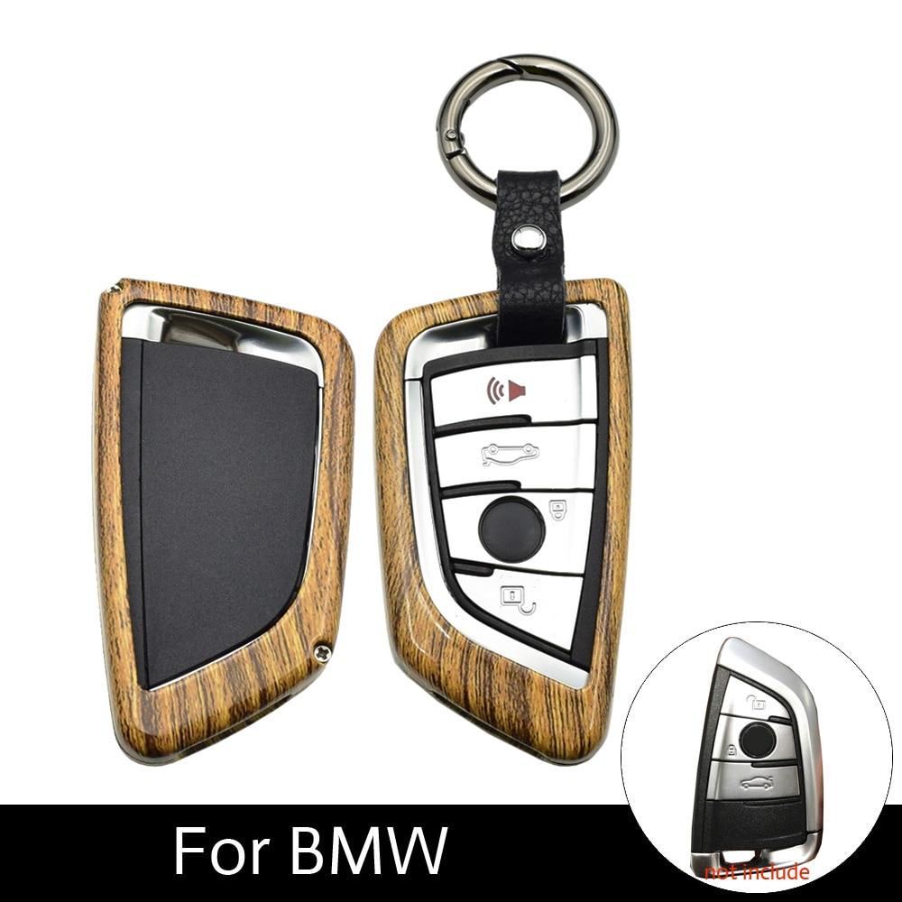 ATOBABI Galvanized Alloy Wood Gain Key Fob Cases For BMW 1 2 Series BMW X5 X6 X1 F48 F16 F15 Keychain Carbon Fiber Pattern Cover