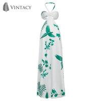 Vintacy סקסי חוף שמלת חופשת קיץ הלטר סטרפלס הולו מתוך ללא משענת שמלות מקסי הדפסת ראפלס טרופי שמלה לבנה