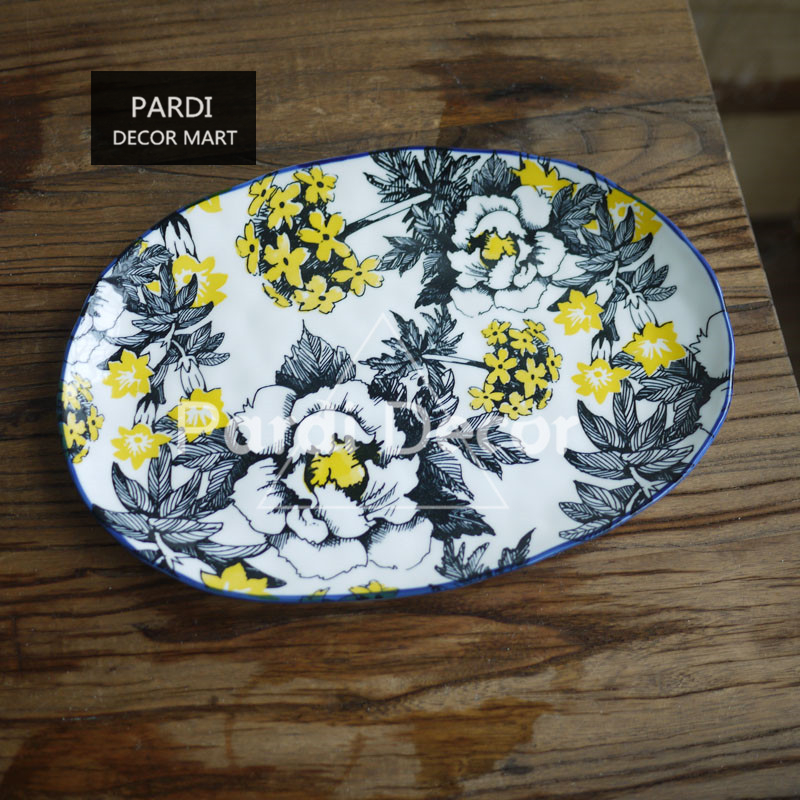 Export European hand kneading irregular line drawing yellow glazed ceramic fish plate long plate oval plate