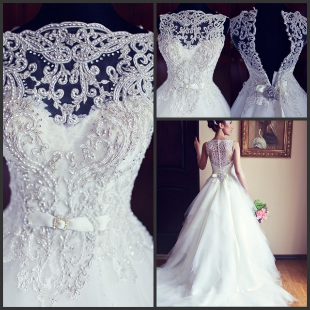 Sexy New Sleeveless A Line Tullle Wedding Dresses Applique Beaded Court Train Bridal Gowns With Buttons Back