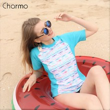 Charmo Women Short Sleeve Rashguard Surf Shirt Swimsuits Geometric Print Swimwear Surfing Top Running Rash Guard UPF50+ Biking
