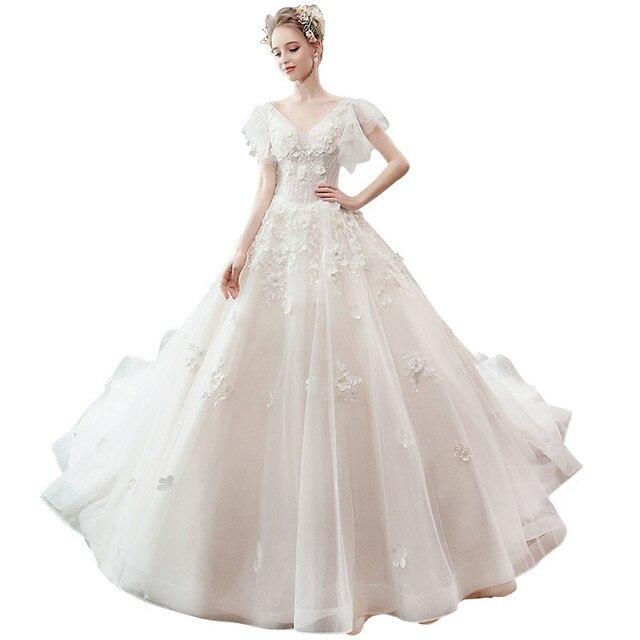 e87ccef095c iLoveWedding Elegant Slim Wedding Dress Ball Gown Champagne V-neck Lace  Applique Vestidos de Novia Lace up Princess Bridal Gown