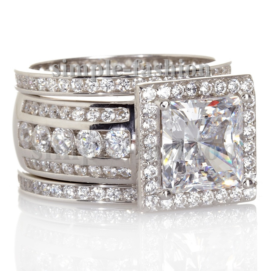 wedding band shopping any bees with a wide diamond band or 2 wedding bands wide band wedding rings and you can never have enough sparkle Hehe let me know what u ladies think Should I go with a wide diamond band or two matching diamond bands
