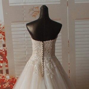 Image 4 - Vestido de novia SF1129, de muestra Real, corte en A, escote Corazón, apliques en el escote, vestidos de boda con dobladillo ancho