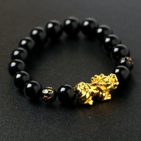 Gold Bracelet With A Brave Transport Bead Obsidian Black Onyx Beads Six Words Of Men And