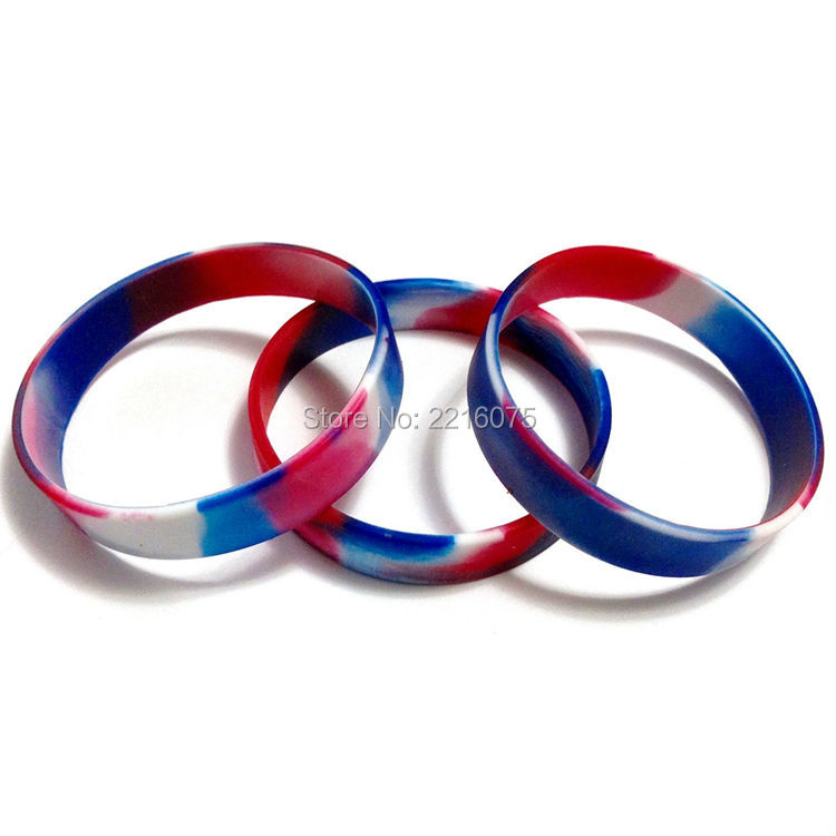 Us 50 0 100pcs Red White Blue Swirl Silicone Wristband Rubber Bracelets Free Shipping In Cuff From Jewelry Accessories On Aliexpress