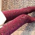 Primavera e no outono estilo novo broto de seda escavar nove minutos de calças Net fios emenda da pele do falso das mulheres leggings rosas