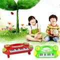 MÚSICA PARA BEBÉS NIÑOS de DIBUJOS ANIMADOS PIANO ELECTRÓNICO DEL TECLADO de PIANO ÓRGANO EDUCATIVO JUGUETE de INSTRUMENTOS MUSICALES de COLOR AL AZAR