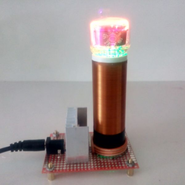 Small Tesla coil  wireless transmission with one Glow lamp small music tesla coils plasma speakers wireless lighting ion windmills electronic toys gifts