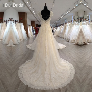 Image 2 - Boné manga v decote vestido de casamento com pérola de luxo frisado delicado laço nupcial vestido de alta qualidade fábrica feito sob encomenda