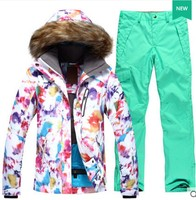43b4c78bb6 Womens snowboarding suit female fur collar white ski jacket and mint green  ski pants winter outdoor
