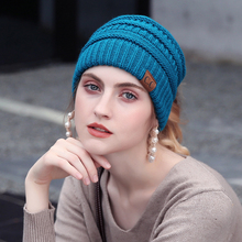 CC Soft Knit Ponytail Beanie Warm Winter Hats For Women Beanie Hat Stretch Cable Messy Bun Hats Ski Cap