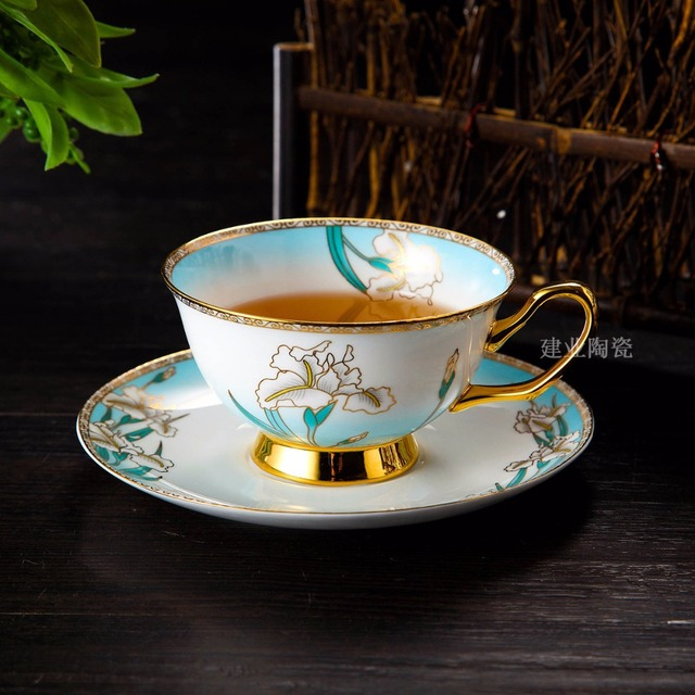 US $29 51 38% OFF|Free Shipping 200ml Gold Rim Bone China tea cup saucer  Set White Orchid Ceramic coffee mug Gift Box Factory direct wholesale-in  Mugs