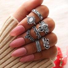 купить 7 Pcs/ Set Retro Bohomia Gem Crystal Hollow Flower Elephant Crown Geometric Round Ring Set Women Charm Party Vintage Jewelry по цене 139.25 рублей