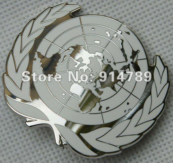 UN UNITED NATIONS METAL BERET CAP METAL PIN BADGE -32357