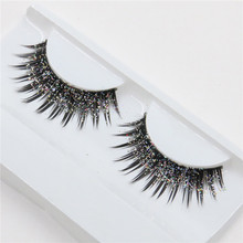 a pair of loaded nightclub makeup exaggerated fashion glitter, fake eyelashes false eyelashes