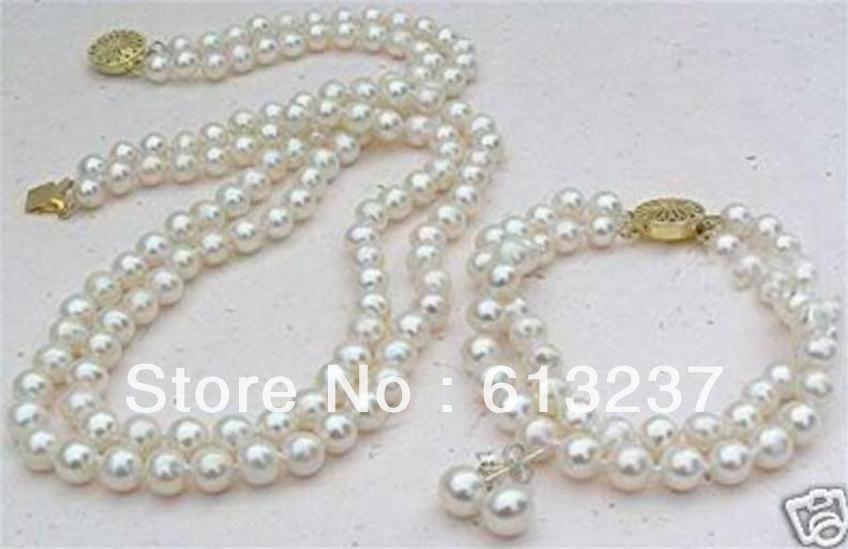 1374c8a36e20 Envío gratuito nuevo estilo de moda 2 filas blanco 8mm Conchas simulado- perla collar pulsera pendiente redondo Cuentas joyería conjunto g4540