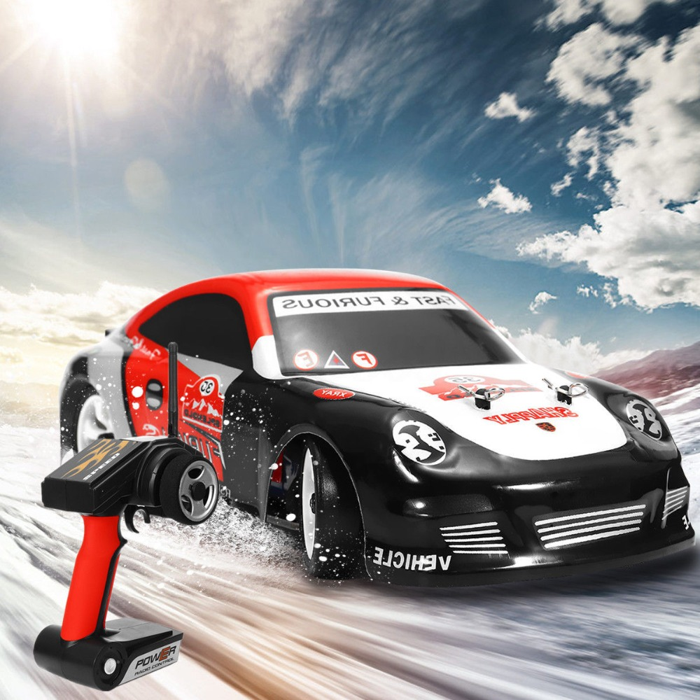 Wltoys K969 <font><b>1</b></font>:28 Scale 30KM/H High Speed Mini RC Car 2.4G 4WD RTR Brushed Remote Control Car RC Drift Car <font><b>Voiture</b></font> Telecommande image