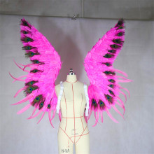 Adult angel feathered wing model shows off adult costume stage to perform Halloween cosplay prop