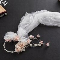 Les nouveaux cheveux de fleur avec rose doux cheveux de mariage voile de mariage robe bijoux accessoires