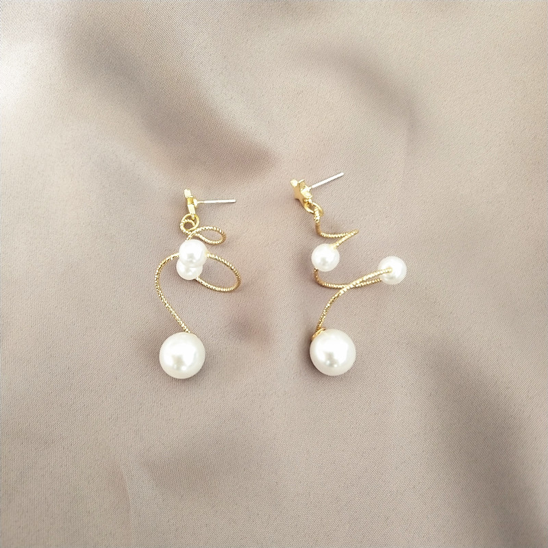 Korean temperament long Earrings spiral pearl sweet girl retro simple drop earrings jewelry earrings in Drop Earrings from Jewelry Accessories
