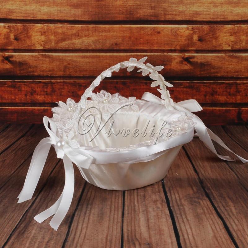 Ribbons onto baskets flower girl : White wedding basket for flower girl with flowes