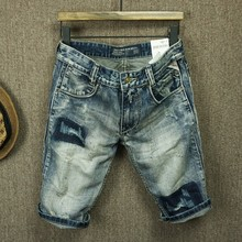 The summer youth hole patch slim denim shorts and retro old loose small straight male pants