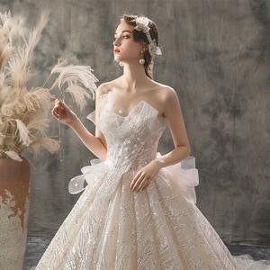 Image 2 - 2020 新夫人勝利ウェディングドレスセクシーなストラップレスの夜会服の高級ケバケバビーズ王女 Vestido デ Noiva ローブ · デのみ