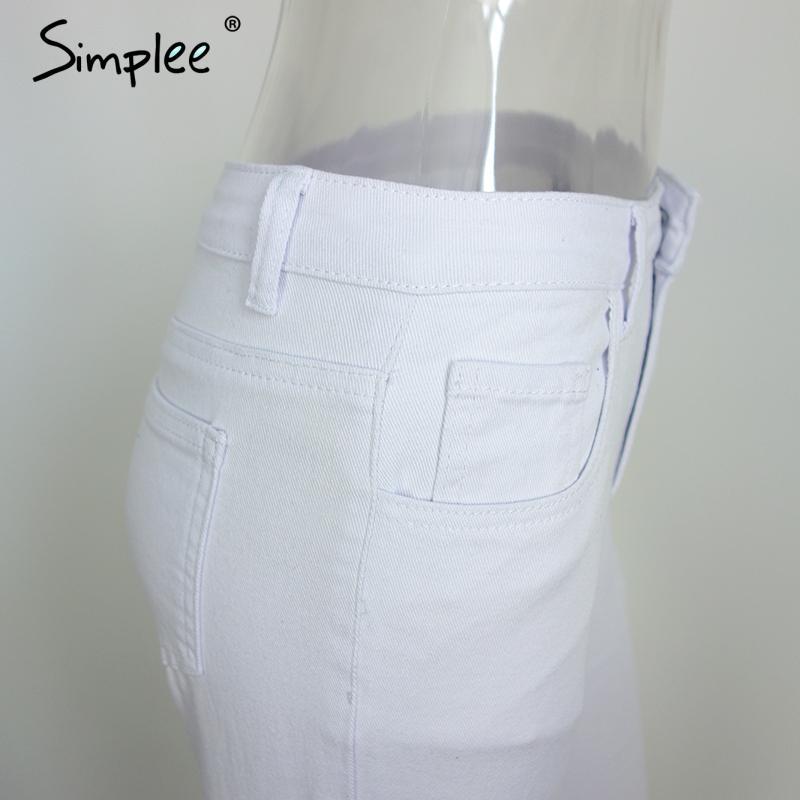 white ripped pants