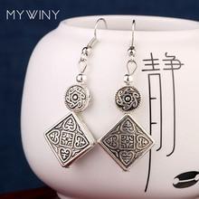 c97cab03b24f La etapa vintage bricolaje Tivetan estilo Miao plata pendientes nuevo chino  viento moda joyas de metal de plata