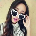 Peach heart sunglasses, Japan and South Korea of heart-shaped sunglass fashionistas love sunglasses tide beach photos of glasses